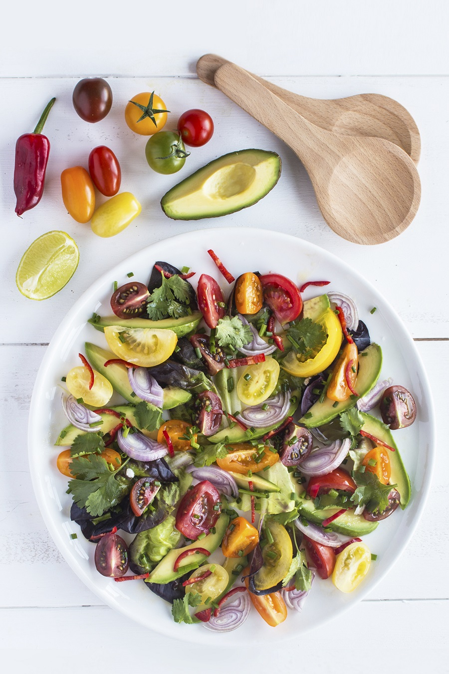 Isle of Wight Tomato Avocado And Red Onion Salad With A Lime And Chilli Dressing.