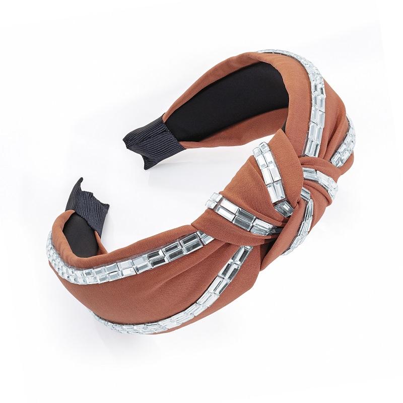 Dark peach colour and crystal knot design headband.